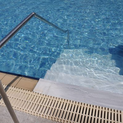 vibrant swimming pool entrance with stairs and ladder