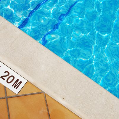 close-up photo of a 1.2m pool depth sign at the swimming pool